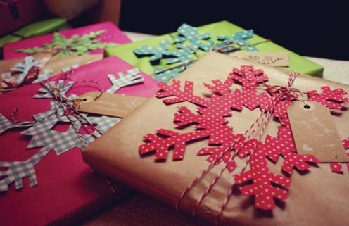 Christmas gift wrapping w/paper snowflakes via Thecarolinejohansson.com
